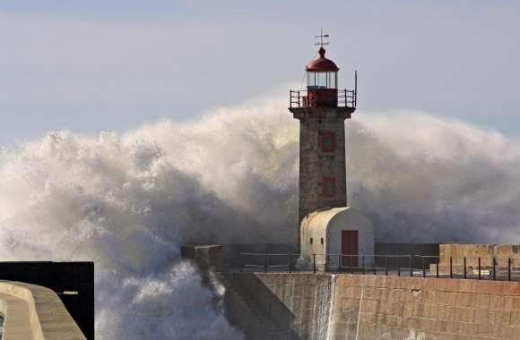 A Huge Wave Crashing Over A Lighthouse