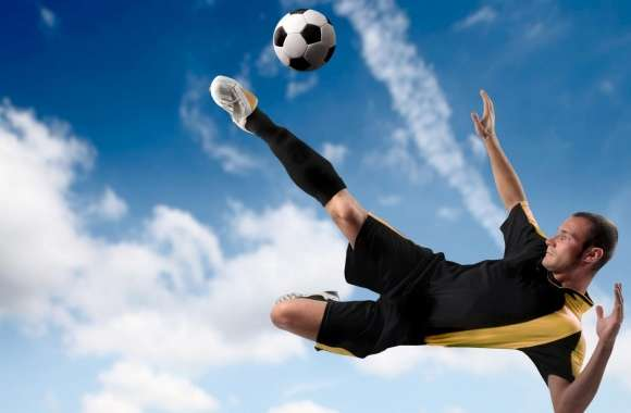 Football Player Kicking The Ball in Mid Air wallpapers hd quality