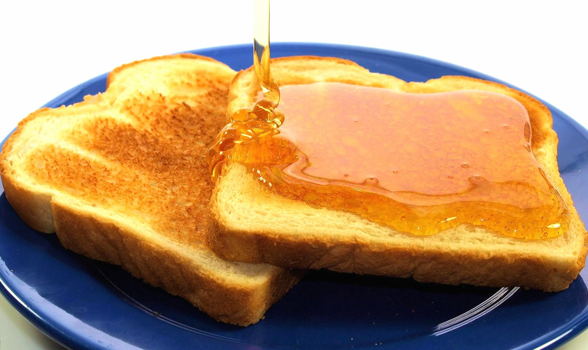 Slices of toast with honey wallpapers HD quality