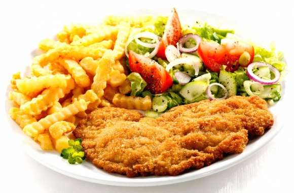Breaded steak vegetables and chips
