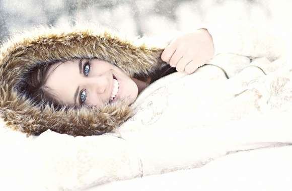 Girl with blue eyes lying in the snow wallpapers hd quality