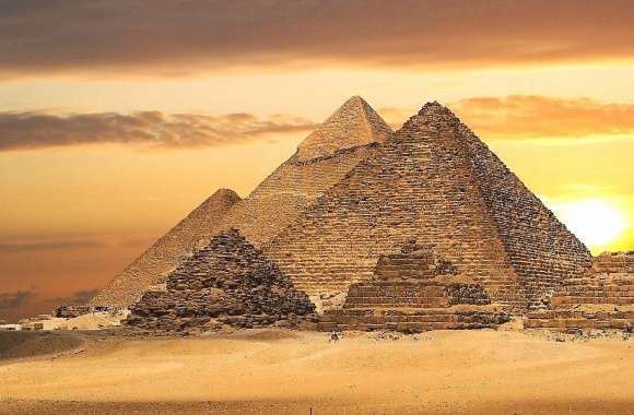 sunset in giza with pyramids