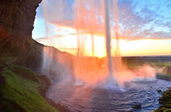 Tall waterfall in the sunset